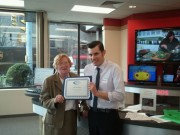 Chamber Vice President, Linda Kane presents Certificate of Appreciation to Jason Termini, Manager of Verizon Retail Store and host of 4/12/2011 Business After Hours event.